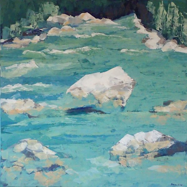 In whitewater stretch, the turquoise river is breaking through the white george